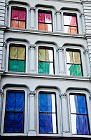 New York, New York City. Building with rainbow colored drapes in the windows.