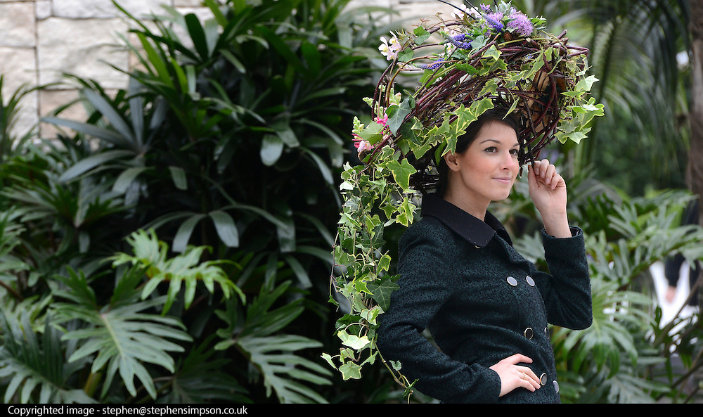 © Licensed to London News Pictures. 21/05/2012. Chelsea, UK Press. A model wears a hat made of twigs and ivy.  preview of The Chelsea Flower Show today 21 May 2012. The world's most famous flower show, which has been held in the grounds of the Royal Chelsea Hospital since 1913, will be open to the public from Tuesday. Visitors are expected to flock in their thousands to see displays of plants, flowers and furniture for ideas on how to decorate their gardens.. Photo credit : Stephen Simpson/LNP