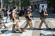 Members of an Ohio militia group protest by openly carrying military style semi-automatic weapons downtown near the Republican National Convention July 19, 2016 in Cleveland, Ohio.