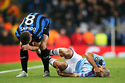 Manchester City forward Sergio Aguero (10) is brought down by Atalanta midfielder Marten de Roon (15) and Atalanta midfielder Robin Gosens (8)  during the Champions League match between Manchester City and Atalanta at the Etihad Stadium, Manchester, England on 22 October 2019.
