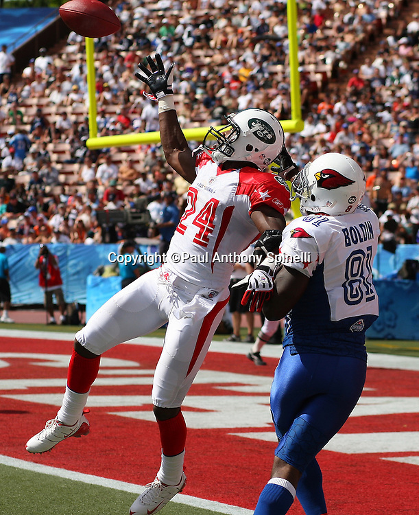 HONOLULU, HI - FEBRUARY 08: AFC All-Stars cornerback Darrelle Revis #24 of the New York Jets leaps and intercepts an end zone pass intended for wide receiver Anquan Boldin #81 of the Arizona Cardinals of the NFC All-Stars in the 2009 NFL Pro Bowl at Aloha Stadium on February 8, 2009 in Honolulu, Hawaii. The NFC defeated the AFC 30-21. ©Paul Anthony Spinelli *** Local Caption *** Darrelle Revis;Anquan Boldin