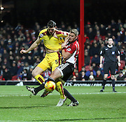 Brentford defender Jack O'Connell pulling Burnley defender Michael Keane shirt during the Sky Bet Championship match between Brentford and Burnley at Griffin Park, London, England on 15 January 2016. Photo by Matthew Redman.