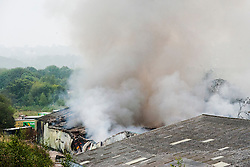 Firefighters are tackling a blaze at a single storey warehouse on a Sheffield Industrial Estate just off Station Road in Ecclesfield close to South Yorkshire Police Sub Divisional HQ and Chapeltown Academy. The fire started just after 9.30pm this evening<br /> <br /> 3 September 2014<br /> <br /> Image © Paul David Drabble <br /> www.pauldaviddrabble.co.uk