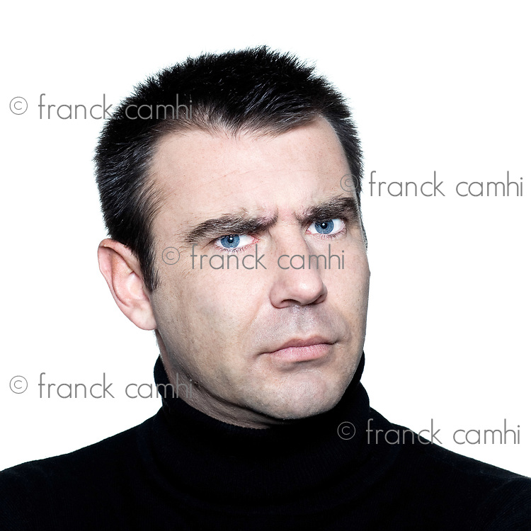 caucasian man portrait angry mistrust suspicious studio isolated white background