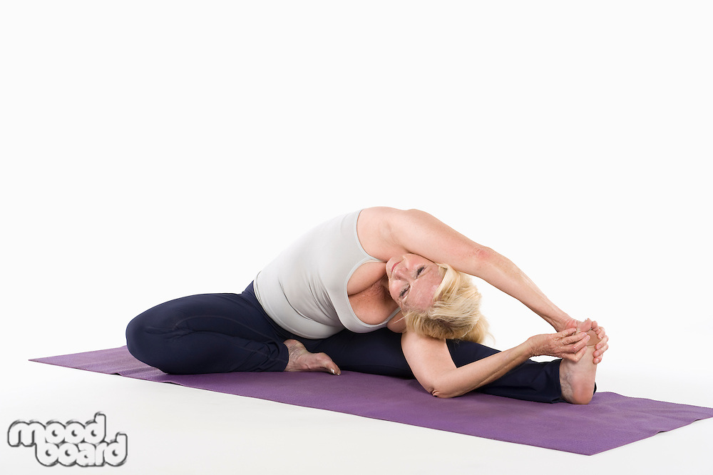 Woman stretching while doing yoga