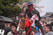 A horse and rider are paraded before the 100,000 strong crowd at the Tado Horse Festival, Japan.