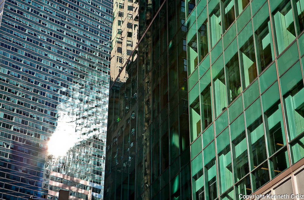 Hi-lights off of glass buildings in Midtown Manhattan.