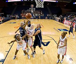 Rhode Island forward Sierra Cooper (30) shoots around Virginia guard Enonge Stovall (40) and center Abby Robertson (30).  The Virginia Cavaliers women's basketball team defeated the Rhode Island Rams 89-53 at the John Paul Jones Arena in Charlottesville, VA on January 9, 2008.