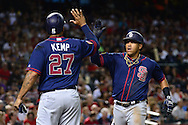 PHOENIX, AZ - JULY 04:  Yangervis Solarte #26 of the San Diego Padres is congratulated by Matt Kemp #27 after hitting a two run home run during the fourth inning against the Arizona Diamondbacks at Chase Field on July 4, 2016 in Phoenix, Arizona.  (Photo by Jennifer Stewart/Getty Images)