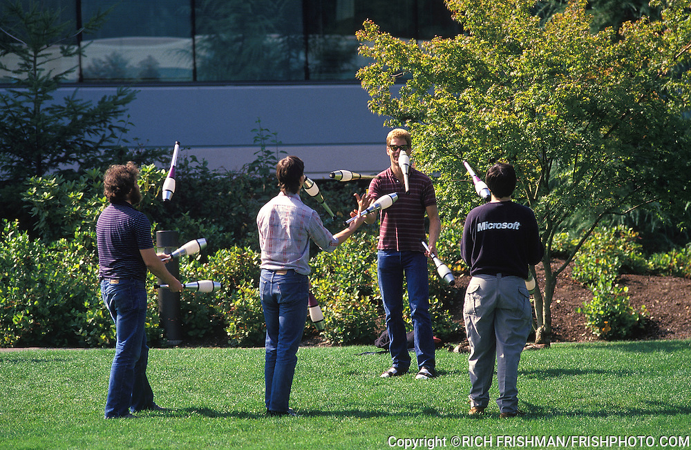 Photograph of the early carefree life at the Microsoft campus in the early 1990's showing engineers and developers juggling on the lawn; Redmond WA.©RICH FRISHMAN.