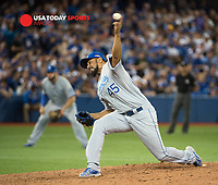Oct 19, 2015; Toronto, Ontario, CAN;  Kansas City Royals relief pitcher Lane Adams (45) pitching in the eighth inning of game three of the ALCS against  Toronto Blue Jays  at Rogers Centre. Mandatory Credit: Peter Llewellyn-USA TODAY Sports