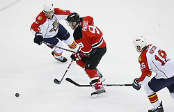 Feb 28, 2009; Newark, NJ, USA; New Jersey Devils left wing Zach Parise (9) skates with the puck past Florida Panthers right wing Nathan Horton (16) during the first period at the Prudential Center.