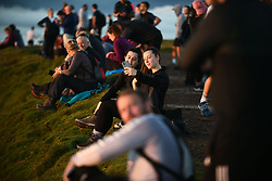 © Licensed to London News Pictures. 08/08/2020. City, UK. Two girls take a selfie during the morning sunrise from the summit of Pen-y-Fan in the Brecon Beacons, on what is expected to be the hottest day of the year across the UK. The mountain which is the highest in southern Britain, has become increasingly popular with visitors who reach the top of the peak at first light to see the sun rising from the horizon. Photo credit: Robert Melen/LNP