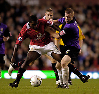Photo: Jed Wee.<br />Manchester Utd v Barnet. Carling Cup. 26/10/2005.<br /><br />Manchester United's Sylvan Ebanks-Blake (L) tussles with Barnet's Nicky Bailey for possession.