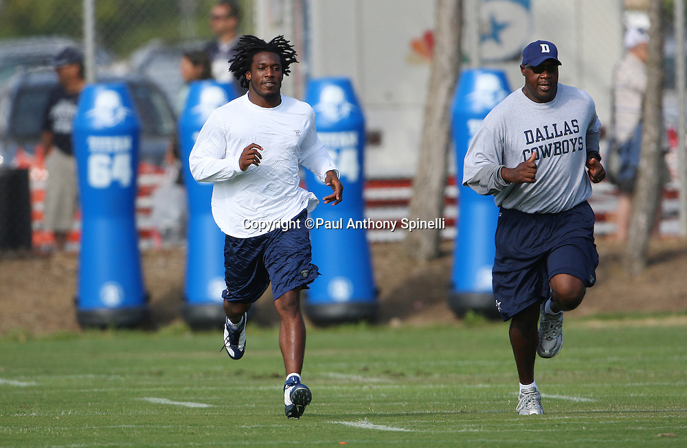 OXNARD, CA - JULY 26:  Rookie cornerback Mike Jenkins #31 of the Dallas Cowboys gets in a brief run with a coach after reporting late to camp during the 2008 Dallas Cowboys Training Camp at River Ridge Field in Oxnard, California on July 26, 2008. ©Paul Anthony Spinelli *** Local Caption *** Mike Jenkins