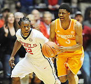 "Mississippi Rebels guard Stefan Moody (42) brings the ball up court against Tennessee Volunteers guard Robert Hubbs III (3) at the C.M. ""Tad"" Smith Coliseum in Oxford, Miss. on Saturday, February 21, 2015. Mississippi won 59-57. (AP Photo/Oxford Eagle, Bruce Newman)"