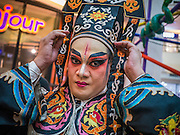 08 FEBRUARY 2013 - BANGKOK, THAILAND: Performers get into character before performing a Chinese opera for Chinese New Year at Seacon Square in Bangkok. Chinese opera is popular in Thailand and is usually performed in the Teochew language. The weeks surrounding Chinese New Year are important for retailers in Thailand and many malls put on special promotions and events honoring Chinese culture, like Lion Dances or Chinese Opera. Thailand has a large Thai-Chinese population. Millions of Chinese emigrated to Thailand (then Siam) in the 18th and 19th centuries and brought their cultural practices with them.    PHOTO BY JACK KURTZ