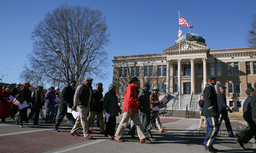 Gary Cosby Jr./Decatur Daily   Marchers parade around the town square in Athens Saturday in honor of Martin Luther King Jr.