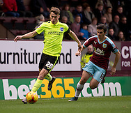 Solly March of Brighton and Hove Albion (left) leaves behind Joey Barton of Burnley during the Sky Bet Championship match at Turf Moor, Burnley<br /> Picture by Russell Hart/Focus Images Ltd 07791 688 420<br /> 22/11/2015