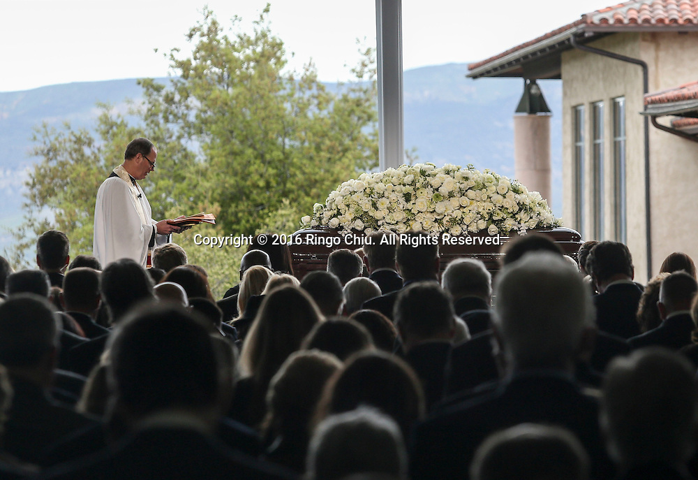 The Rev. Stuart Kenworthy prays as the casket sits on the stage during a funeral service for the former first lady Nancy Reagan at the Ronald Reagan Presidential Library and Museum in Simi Valley, California on March 11, 2016. Reagan died of congestive heart failure in her sleep at her Bel Air home Sunday at age 94. A bout 1,000 guests from the world of politics attended the final farewell to Nancy Reagan as the former first lady is eulogized and laid to rest next to her husband at his presidential library.<br />    (Photo by Ringo Chiu/PHOTOFORMULA.com)<br /> <br /> Usage Notes: This content is intended for editorial use only. For other uses, additional clearances may be required.