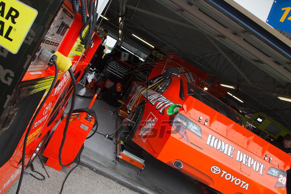 Kansas City, KS - APR 20, 2012:  Joey Logano (20) car in the garage before a practice session for the STP 400 race at the Kansas Speedway in Kansas City, KS.