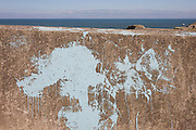Splashed blue paint on the sea wall in the north Devon coastal town of Ilfracombe.
