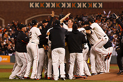 SAN FRANCISCO, CA - JUNE 13: Matt Cain #18 of the San Francisco Giants (center) is congratulated by teammates after the game against the Houston Astros at AT&T Park on June 13, 2012 in San Francisco, California. Cain pitched a perfect game as the San Francisco Giants defeated the Houston Astros 10-0.