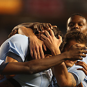 Stevan Jovetic, Manchester City, is mobbed by his team mates after scoring the first of his two goals during the Manchester City Vs Liverpool FC Guinness International Champions Cup match at Yankee Stadium, The Bronx, New York, USA. 30th July 2014. Photo Tim Clayton