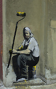 Banksy Street Artist. Painter resting painted on the Pollard Row E2 wall of the Bethnal Green Working Mens Club London.<br /> PIC JAYNE RUSSELL. 01.11.2007