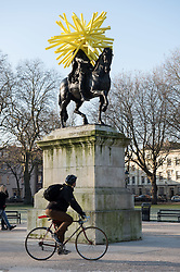 © Licensed to London News Pictures. 01/12/2016. Bristol, UK. A mysterious art work of yellow spikes has appeared on the statue of King William III in Bristol's Queen's Square. It is not known who has placed it there or what it means. Bristol is known for its public and street art. Photo credit : Simon Chapman/LNP