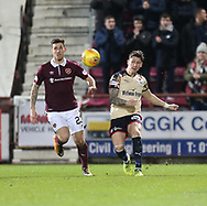 12th December 2017, Tynecastle Park, Edinburgh, Scotland; Scottish Premier League football,  Heart of Midlothian versus Dundee; Dundee's Josh Meekings clears from Hearts' Cole Stockton