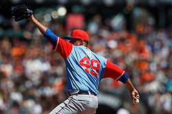 SAN FRANCISCO, CA - AUGUST 26: Yovani Gallardo #49 of the Texas Rangers pitches against the San Francisco Giants during the first inning at AT&T Park on August 26, 2018 in San Francisco, California. The San Francisco Giants defeated the Texas Rangers 3-1. All players across MLB will wear nicknames on their backs as well as colorful, non-traditional uniforms featuring alternate designs inspired by youth-league uniforms during Players Weekend. (Photo by Jason O. Watson/Getty Images) *** Local Caption *** Yovani Gallardo