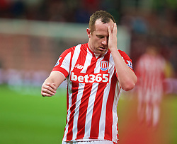 STOKE-ON-TRENT, ENGLAND - Monday, April 18, 2016: Stoke City's Charlie Adam looks dejected as his side lose 4-0 to Tottenham Hotspur during the FA Premier League match at the Britannia Stadium. (Pic by David Rawcliffe/Propaganda)