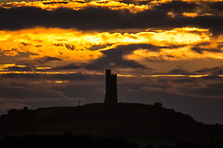 © Licensed to London News Pictures. 31/07/2017. Huddersfield UK. The sun rises this morning behind Victoria Tower on Castle Hill in Huddersfield. The tower was built in 1899 to celebrate 60 years old Queen Victoria's reign & sit's 1000ft above sea level. Photo credit: Andrew McCaren/LNP