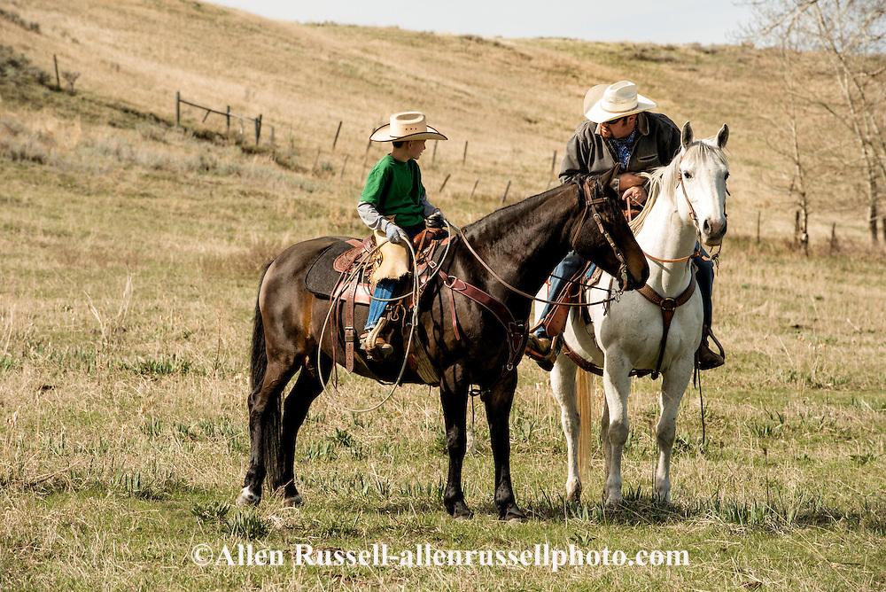 Cowboys, father, son, horseback, Wilsall, Montana, Lazy SR Ranch, Garrett Hamm, son Rodie