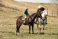 Cowboys, father, son, horseback, Wilsall, Montana, Lazy SR Ranch, Garrett Hamm, son Rodie