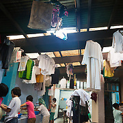 It is laundry day in the center. All the girls are responsible for washing their own clothes and the wash house is busy. Manila, Philippines. Laura Vicuña Foundation, Inc. provides a safe haven, a secure home for girls where they live together with the Salesian Sisters of Don Bosco order. They get the love and care they never have received and psychosocial counseling when needed from qualified psychotherapists. <br />