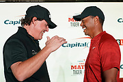 November 20, 2018; Las Vegas, NV, USA; Phil Mickelson (left) and Tiger Woods (right) shake hands during a press conference before The Match: Tiger vs Phil golf match at Shadow Creek Golf Course.