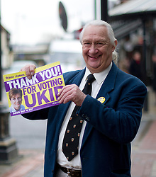 © London News Pictures. 01/03/2013 . Eastleigh, UK.  A UKIP (UK INdependence Part) supporter handing out 'Thanks you for voting UKIP' posters in Eastleigh town centre after the party came second in the Eastleigh by-election. Photo credit : Ben Cawthra/LNP