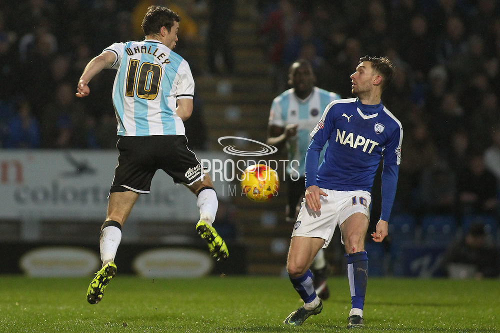 Shrewsbury Town FC midfielder Shaun Whalley and Chesterfield FC midfielder Jay O'Shea challenge for the ball during the Sky Bet League 1 match between Chesterfield and Shrewsbury Town at the Proact stadium, Chesterfield, England on 2 January 2016. Photo by Aaron Lupton.
