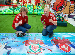 NANNING, CHINA - Thursday, March 22, 2018: Wales supporters Ali Talbot from Oswestry and Keith Jones from Froncysyllte at the Nanning Wanda Mall ahead of the 2018 Gree China Cup International Football Championship match between China and Wales. (Pic by David Rawcliffe/Propaganda)