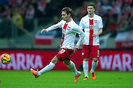 Poland's Ludovic Obraniak controls the ball during international friendly soccer match between Poland and Scotland at National Stadium in Warsaw on March 5, 2014.<br /> <br /> Poland, Warsaw, March 5, 2014<br /> <br /> Picture also available in RAW (NEF) or TIFF format on special request.<br /> <br /> For editorial use only. Any commercial or promotional use requires permission.<br /> <br /> Mandatory credit:<br /> Photo by © Adam Nurkiewicz / Mediasport