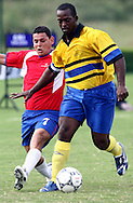 (L) SOCCER PLAYER FROM COSTA RICA (RED) & (R) SOCCER PLAYER FROM BARBADOS (YELLOW) FIGHT FOR THE BALL DURING FOOTBALL COMPETITION AT THE SPECIAL OLYMPICS WORLD SUMMER GAMES SHANGHAI 2007..SPECIAL OLYMPICS IS AN INTERNATIONAL ORGANIZATION DEDICATED TO EMPOWERING INDIVIDUALS WITH INTELLECTUAL DISABILITIES..SHANGHAI , CHINA , OCTOBER 06, 2007.( PHOTO BY ADAM NURKIEWICZ / MEDIASPORT )..