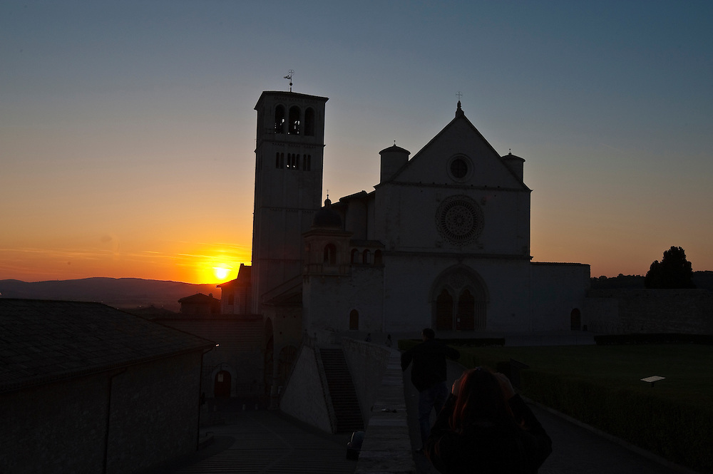 The sun sets behind St. Francis of Assisi Basilica in Assisi, Italy. (Sam Lucero photo)