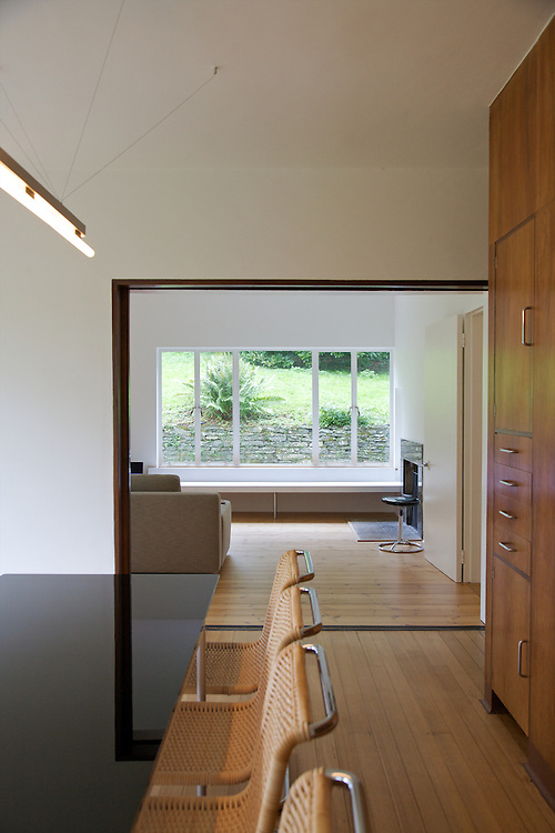 The dining room showing the &quot;green table&quot; (referring to the reflections) looking through to the living room at Warren House, Wayne McGregor's Dartington Estate home in Devon<br /> Vanessa Berberian for The Wall Street Journal