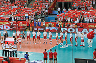 LODZ, POLAND - SEPTEMBER 16: Players of Poland during the national anthem ceremony during the FIVB World Championships match between Poland and Brazil on September 16, 2014 in Lodz, Poland. (Photo by Piotr Hawalej)