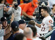 Jun 22, 2016; Houston, TX, USA; Houston Astros second baseman Jose Altuve (27) is congratulated in the dugout after hitting a home run against the Los Angeles Angels in the sixth inning at Minute Maid Park. Mandatory Credit: Thomas B. Shea-USA TODAY Sports