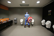 UNITED KINGDOM, London: 24 February 2013. <br /> Comic Con Feature.<br /> 'Captain America' takes a break at the ExCel Arena during the MCM London Comic Con 2013..<br /> Photo: Rick Findler / Story Picture Agency