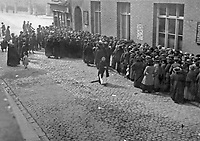 A crowd outside the city dispensary on Castle St waiting for bread supplies, 1916. The gates of Christ Church Cathedral can be seen at the top of the picture. (Part of the Independent Newspapers Ireland/NLI Collection)
