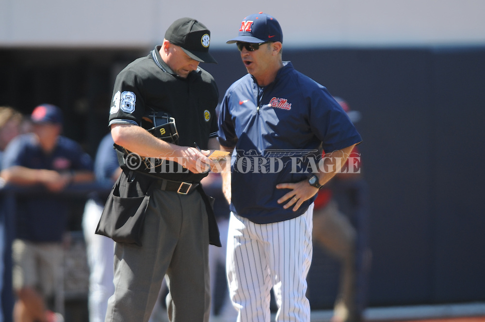 Mississippi coach Mike Bianco (5) talks to home plate umpire Scott Cline (38) after third base coach Cliff Godwin was ejected vs. LSU at Oxford-University Stadium in Oxford, Miss. on Saturday, April 19, 2014. (AP Photo/Oxford Eagle, Bruce Newman)